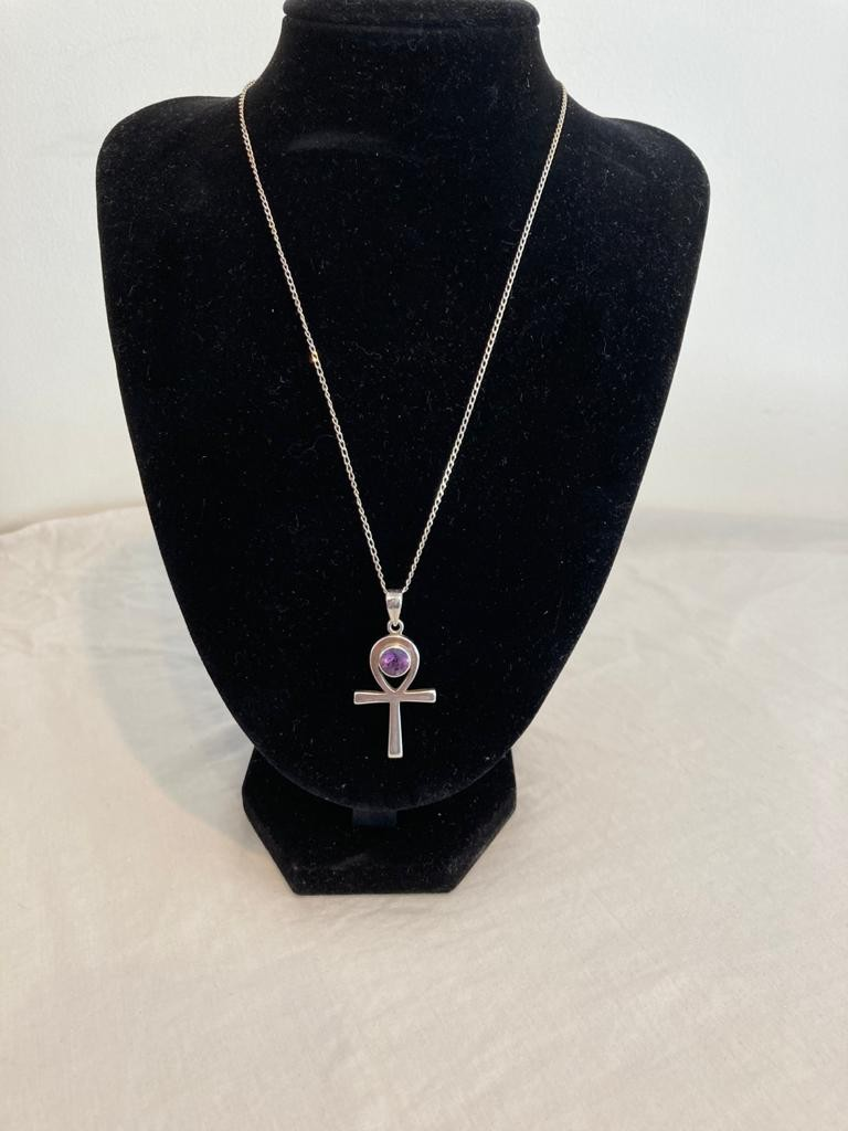 Silver Celtic cross set with large circular amethyst mounted on silver chain. Silver chain 45 cm