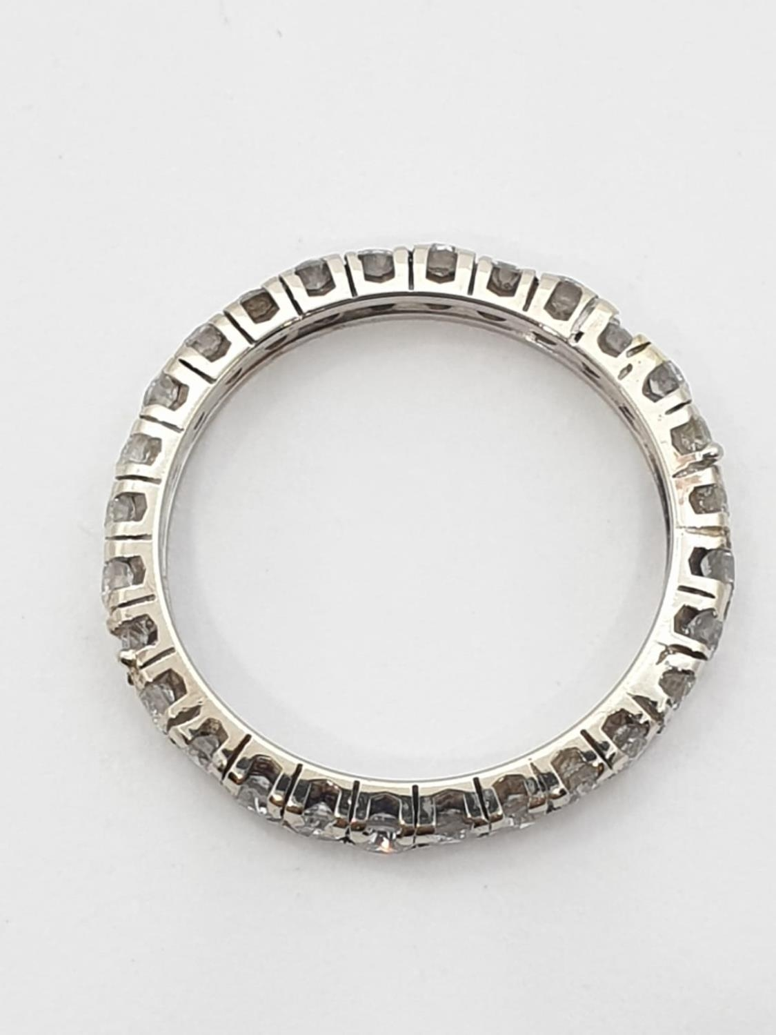 Diamond full eternity ring (tested 18ct gold), weight 2.27g and size J - Image 2 of 3