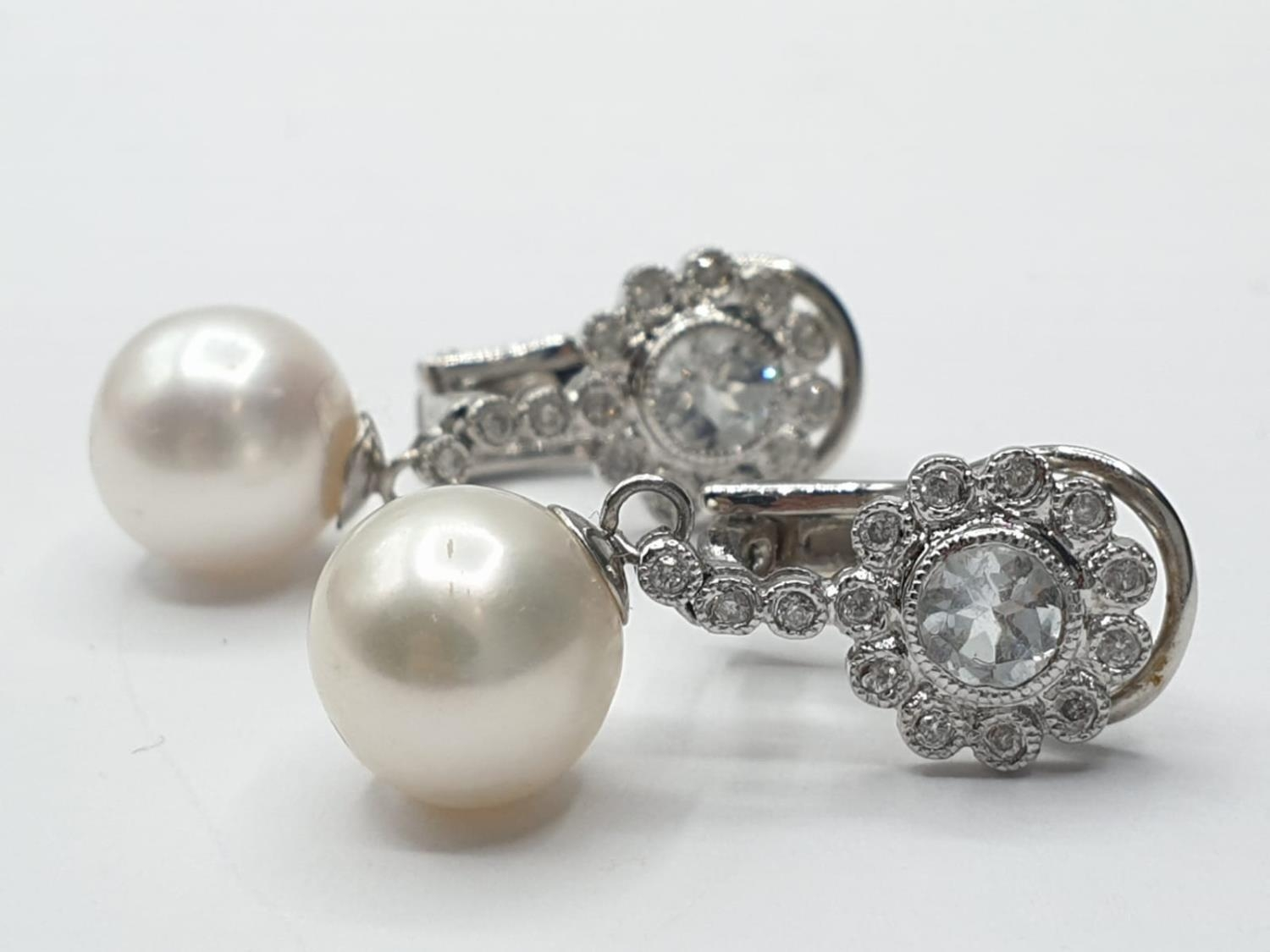 Pair of 18ct gold pearl and white sapphire drop earrings in floral design, weight 6g and 2.5cm