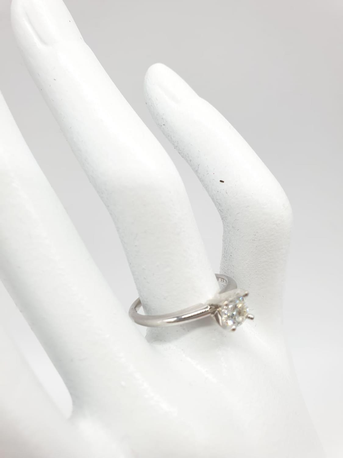 14ct white gold with 0.56ct diamond solitaire ring (round brilliant cut, colour H, clarity SI1 - Image 4 of 18