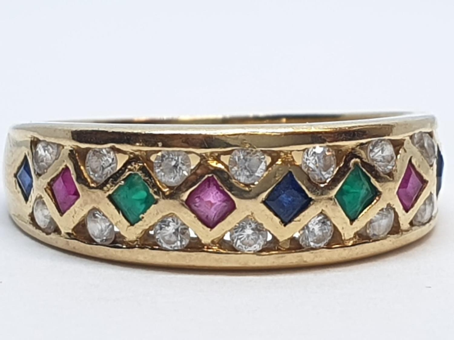 18ct Yellow gold diamond ruby, sapphire and emerald set fancy ring. Weight 4.3g, Size S.