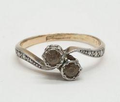 9ct Gold and platinum ring having two pale aqua stones to top in crossover style. Preserved in