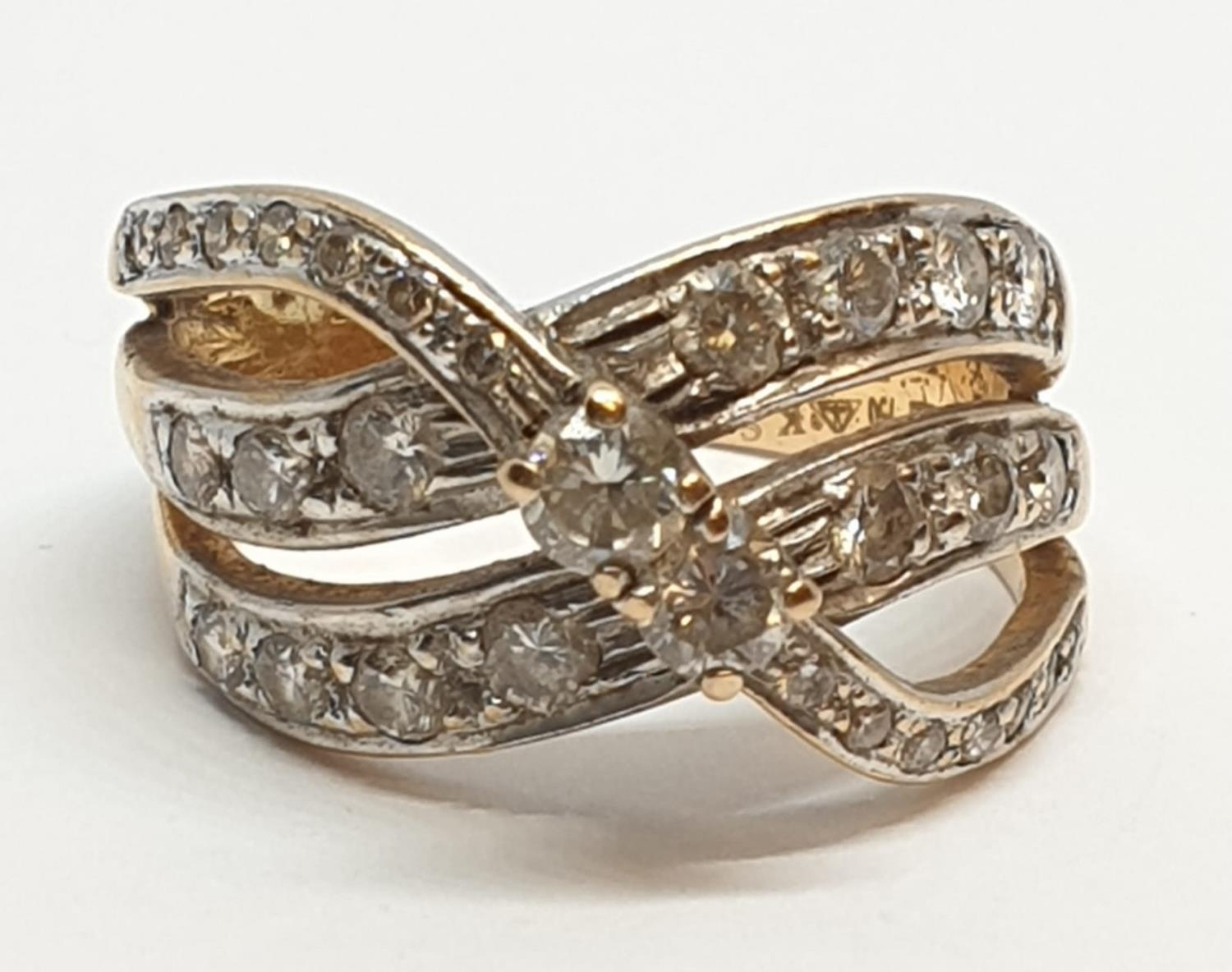 18ct Yellow gold diamond set fancy three row twist band ring. Weight 8.5g, Approx. 0.60ct of