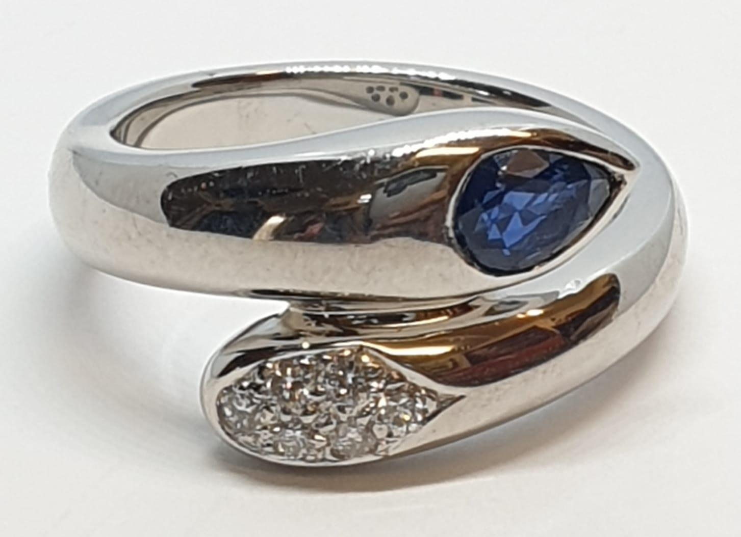 Platinum cross over ring with 0.60ct Thai sapphire and 0.30ct encrusted diamonds, weight 13.7g and - Image 8 of 10