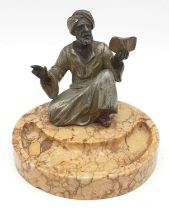 Ashtray of a Moroccan preacher man figurine on a marble base. Height 11cm.