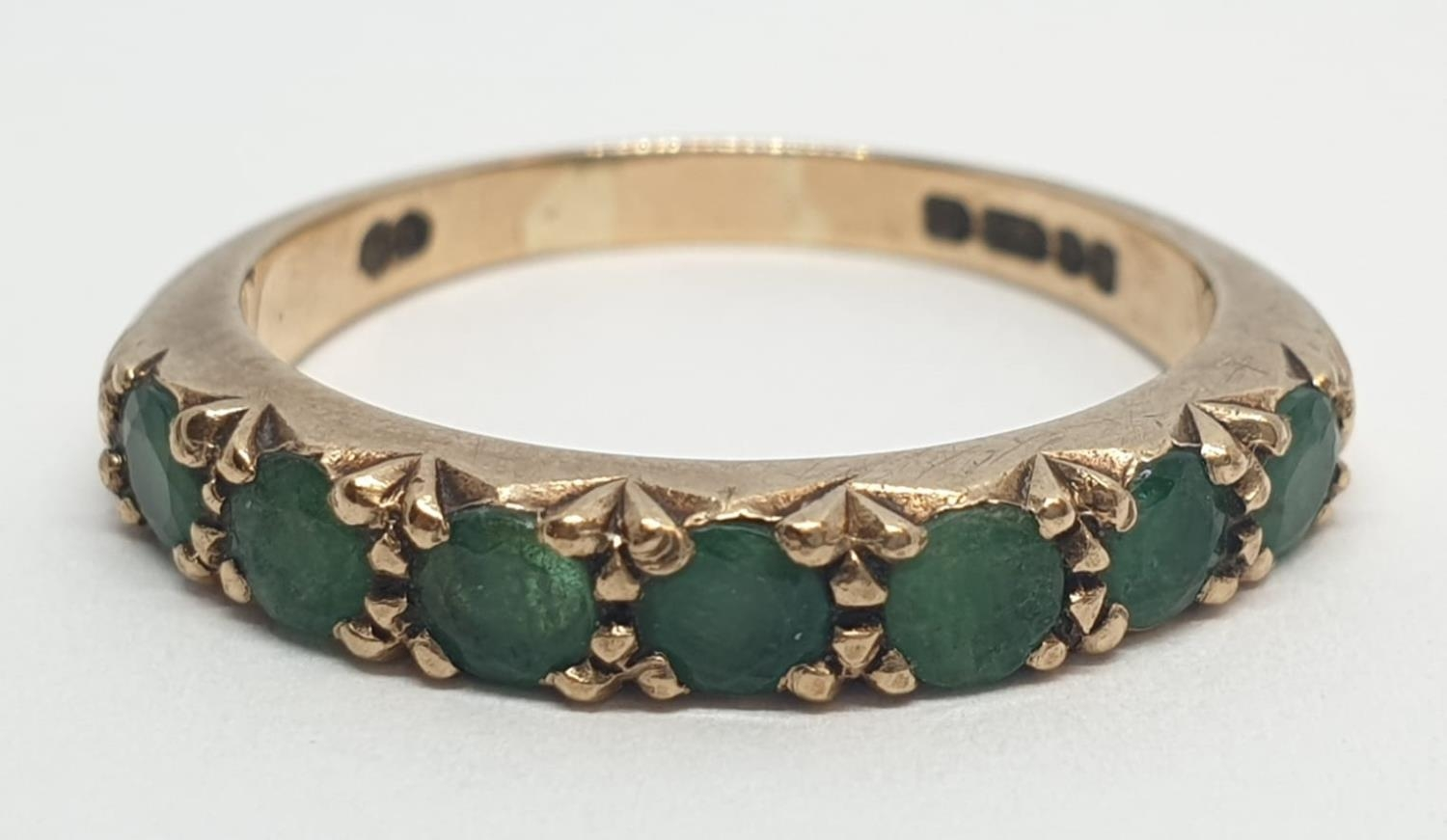 9ct Yellow gold emerald half eternity ring. Weight 2.8g, Size O.