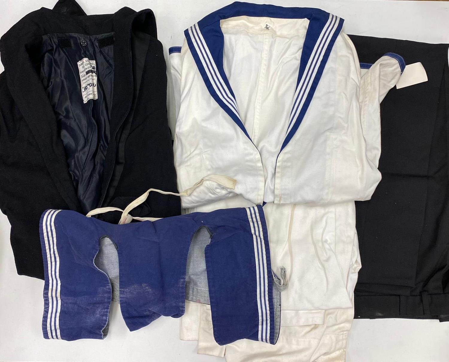 Box of numerous naval uniforms. Female and Male. Trousers, skirts, shirts and blazers.