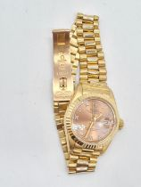 18ct gold Rolex oyster perpetual Datejust ladies watch with rose gold face and Roman numerals,