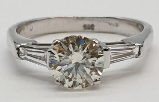 14ct white gold ring with 1.02ct diamond centre (colour J, clarity VS1) and 2 baguette cut