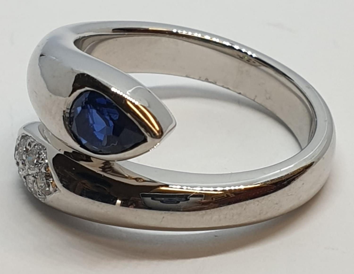 Platinum cross over ring with 0.60ct Thai sapphire and 0.30ct encrusted diamonds, weight 13.7g and - Image 4 of 10