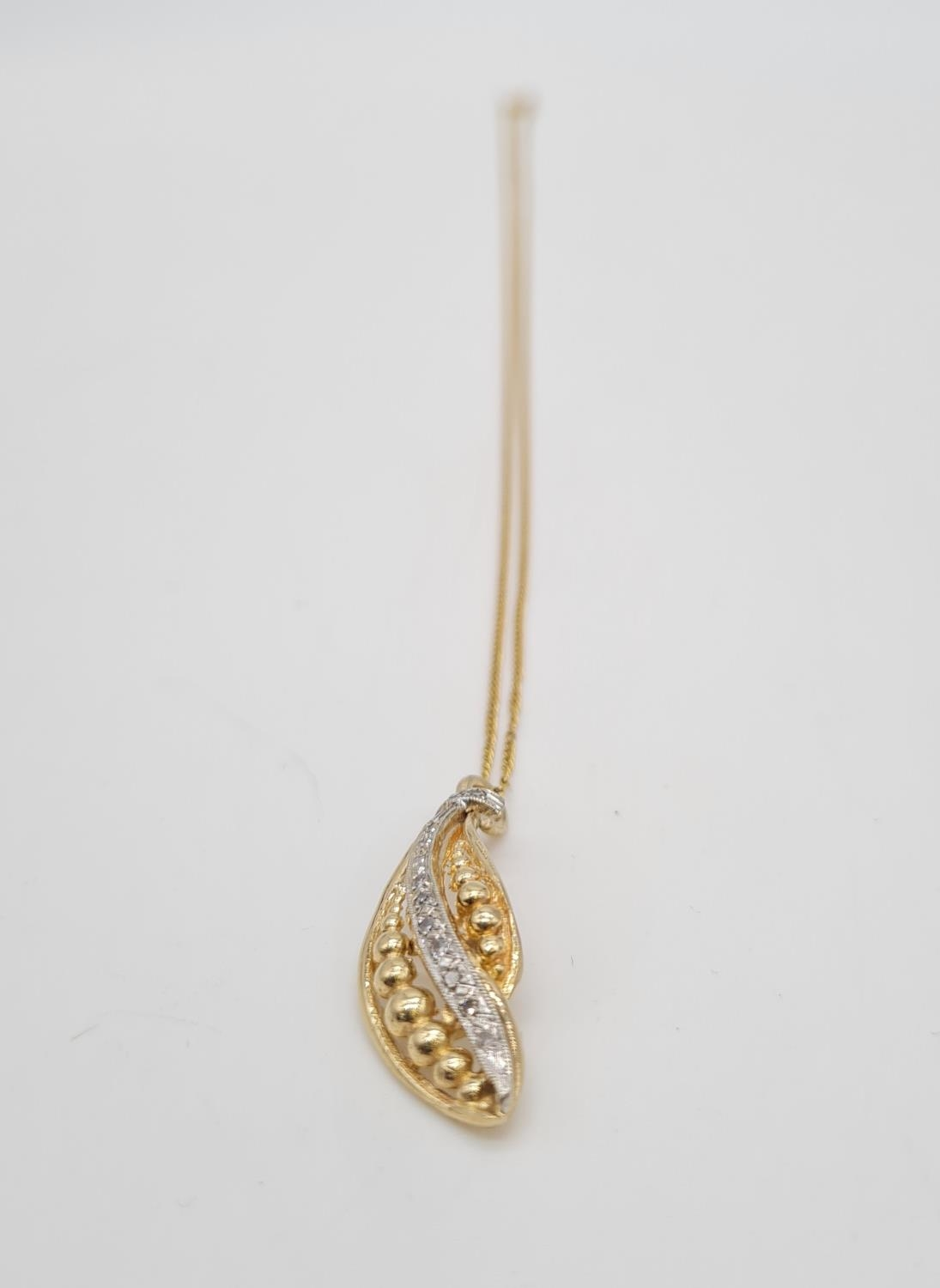 18ct gold diamond set pendant on chain, weight 3.69g and 40cm long, pendant 3 x 1cm - Image 6 of 9