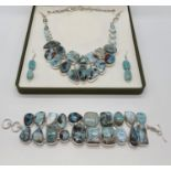 A larimar necklace, bracelet and earrings set in a presentation box. Total weight: 228g./ LARIMAR is