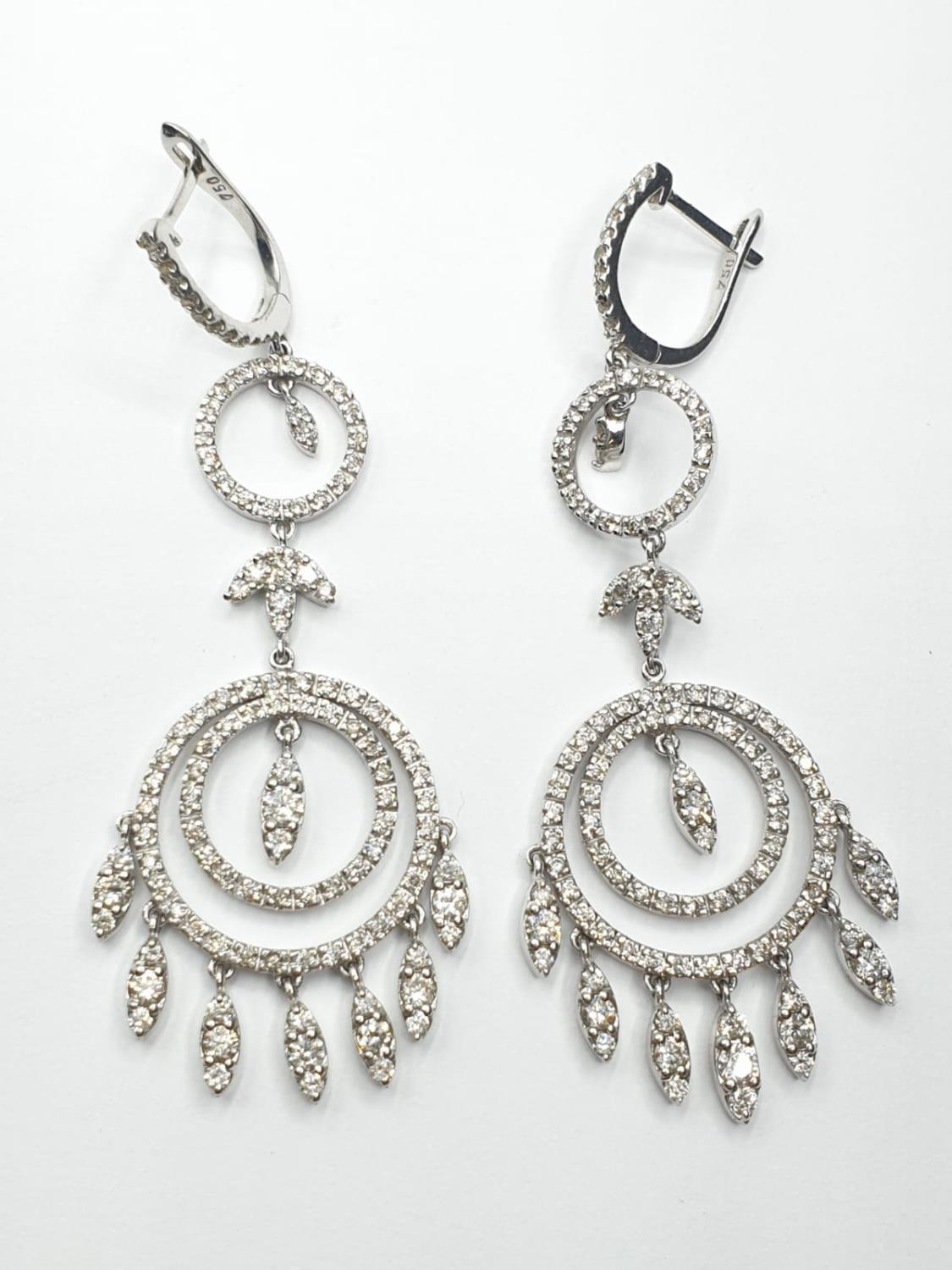 Pair of 18ct white gold and diamond drop earrings in the shape of dream catchers, weight 15.82g