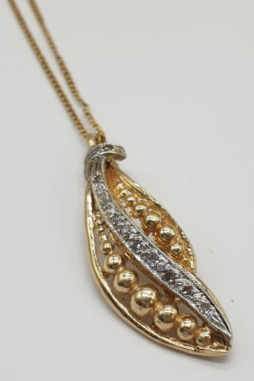 18ct gold diamond set pendant on chain, weight 3.69g and 40cm long, pendant 3 x 1cm