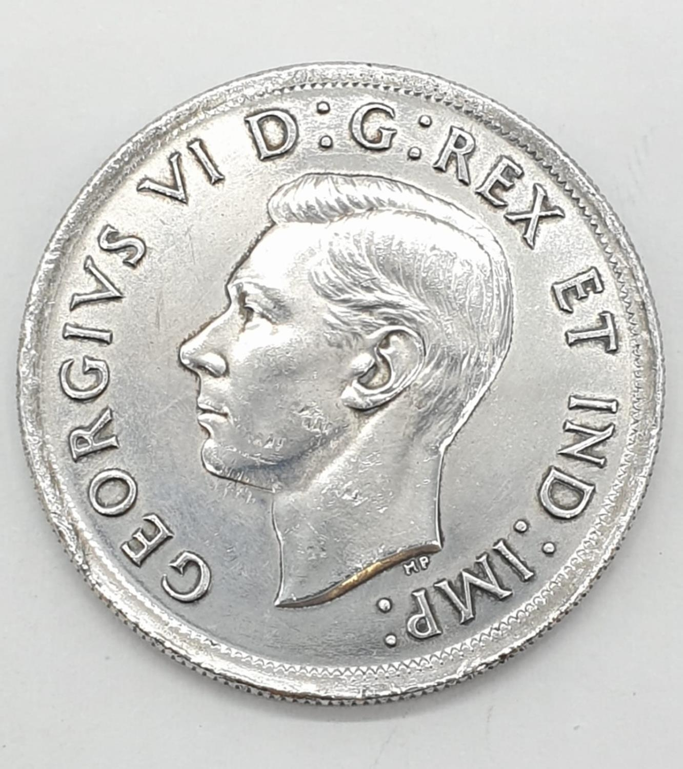 Silver 1939 Canadian 'Ottawa' dollar. Clear and raised definition to both sides. Slight nicks to - Image 2 of 3