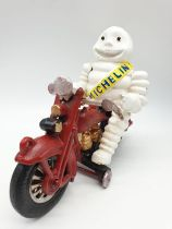 A collector?s item, French, cast iron, MITCHELIN MAN, on a motorbike. Wheels turning with special