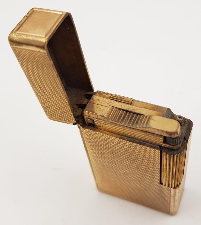 A vintage gold-plated S.T Dupont lighter. - Image 2 of 3