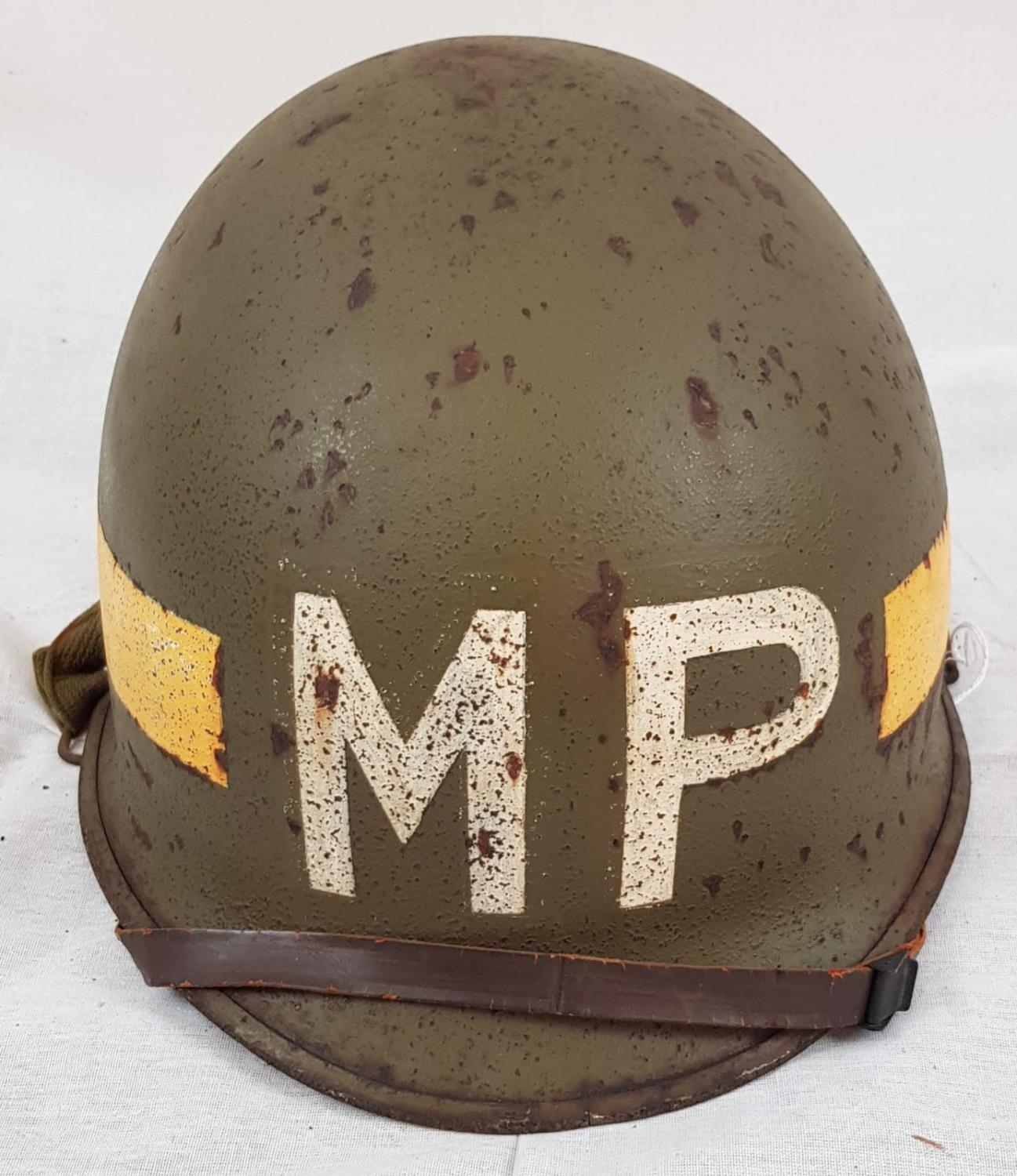 WW2 US M1 Military Police Front Seam Helmet & Liner. The Helmet was made by McCord with the batch