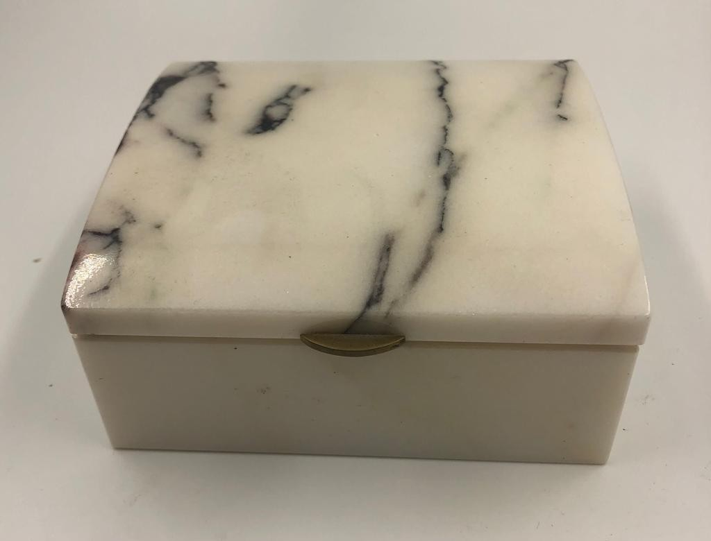 Mable cigarette box made from the marble taken from the demolished London stock exchange in 1970