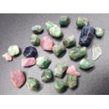 88.15 Ct Group of assorted rough Rubies, Emeralds & Blue Sapphires