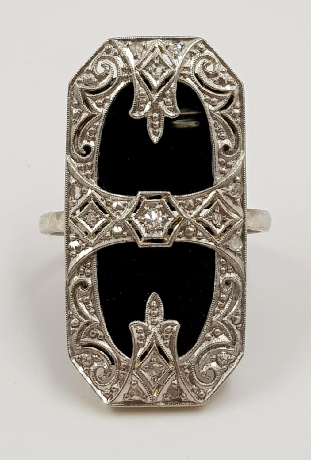 An art deco, platinum and black onyx ring. 6.6g total weight and size J. - Image 2 of 3