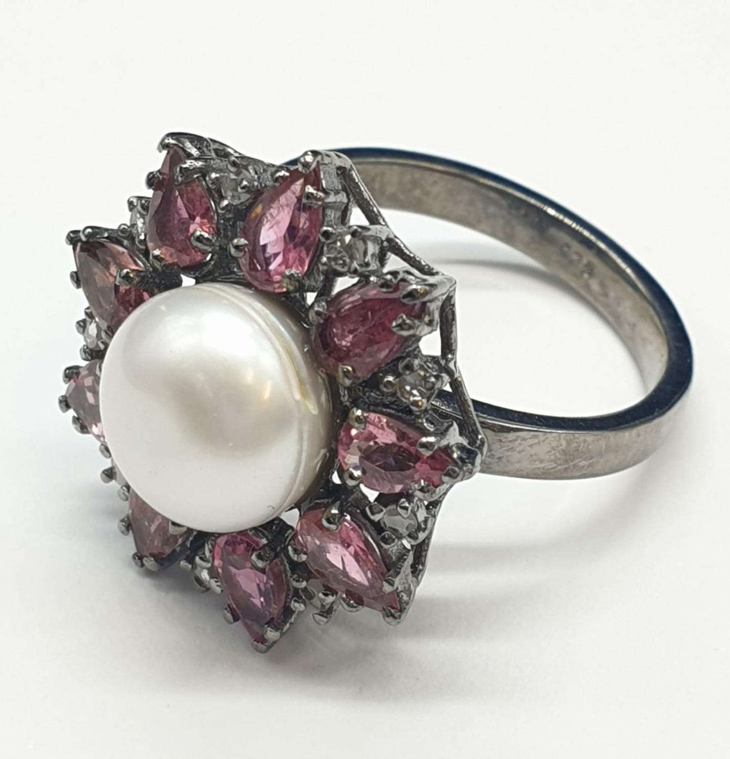 4.40 Cts Pearl & 2.35 Cts Pink Tourmalines set inside a 925 Blackened silver ring. With 0.20 Cts - Image 2 of 7