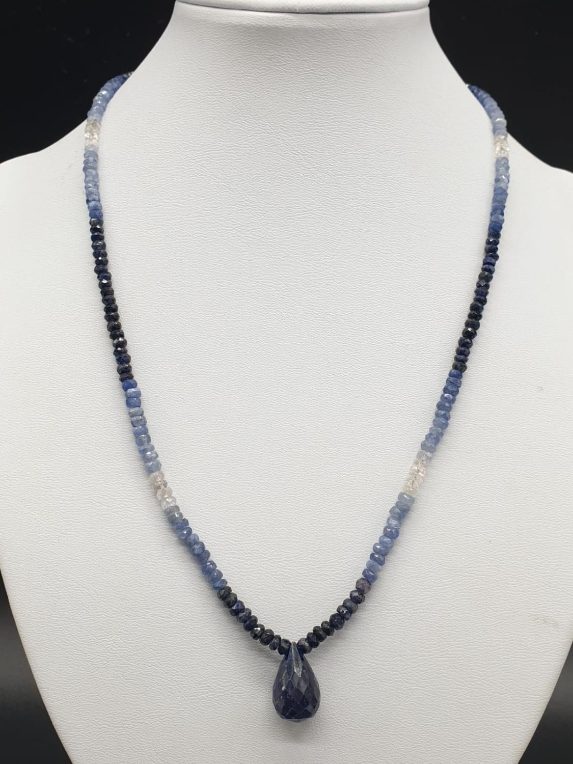 A shaded Blue sapphire Necklace with a sapphire drop and matching dangler earrings. Necklace - Image 2 of 6