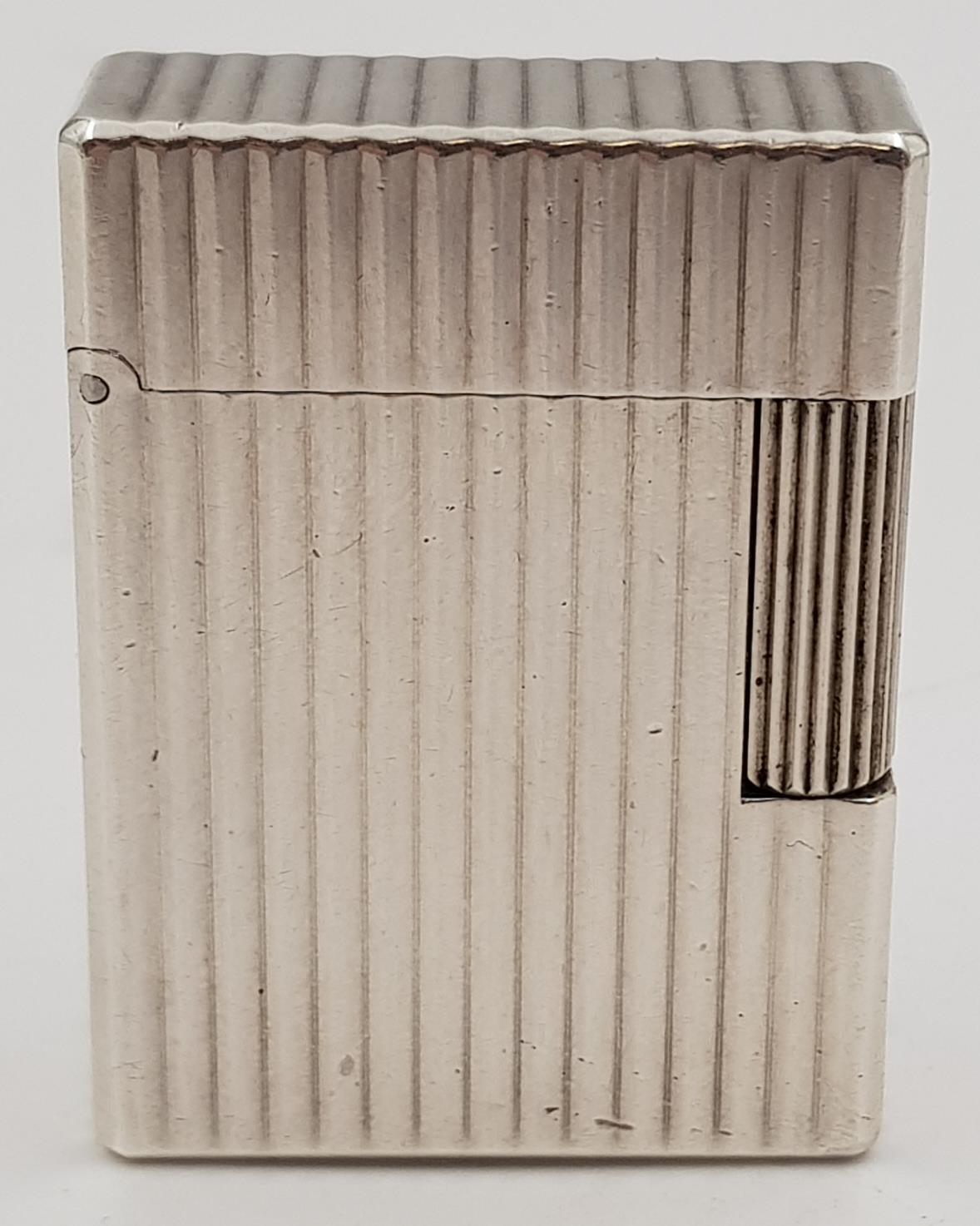 A vintage silver S.T Dupont lighter.