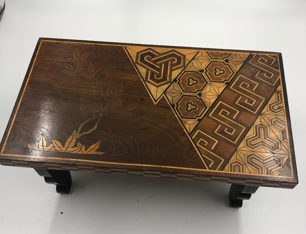A vintage Japanese style mini coffee table with folding legs, stylish engraved and lacquered,