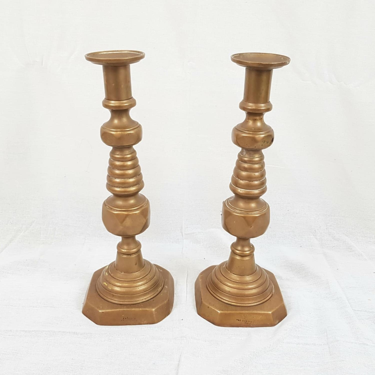 Antique BRASS CANDLESTICKS stamped and dated 1902 Coronation, plus English and registered number.