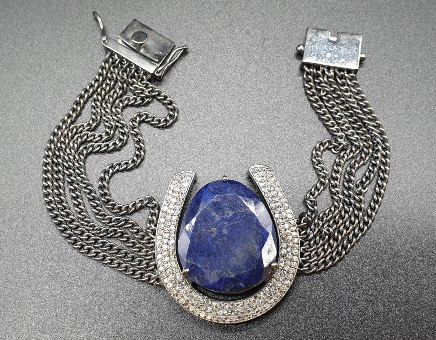 32.10 Cts Blue Sapphire inset a Horse shoe shaped bracelet. With 1.70 Cts Rose cut diamonds.