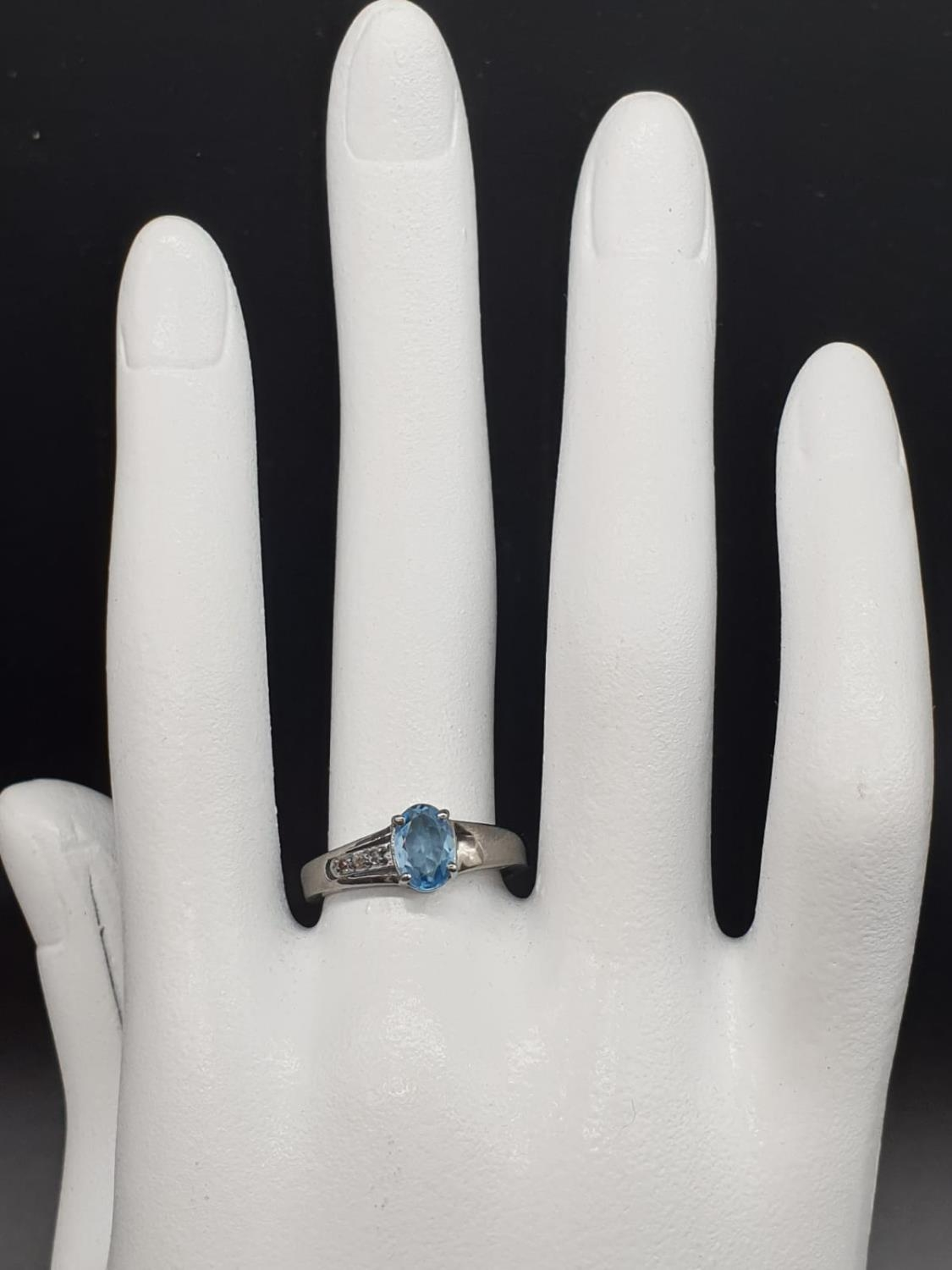 0.86 Ct Blue topaz stone inset a blackened silver ring. With 0.05 Ct rose cut diamonds, weight 2.35g - Image 6 of 7