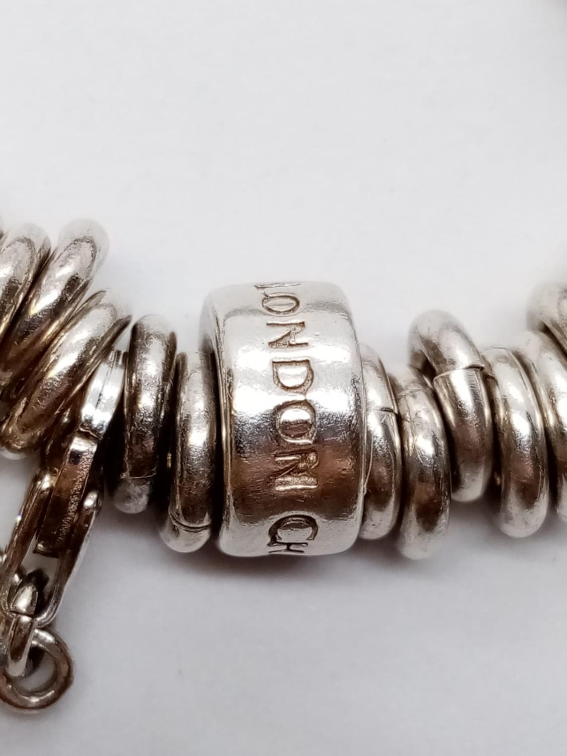 Heavy SILVER BRACELET, London Charm Co. 75.2g 10 charms. - Image 6 of 9