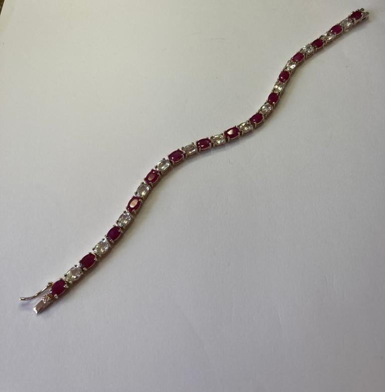 Silver tennis bracelet with pale aqua and pink spinel stones set in four claw mounts. 925 silver. - Image 2 of 4