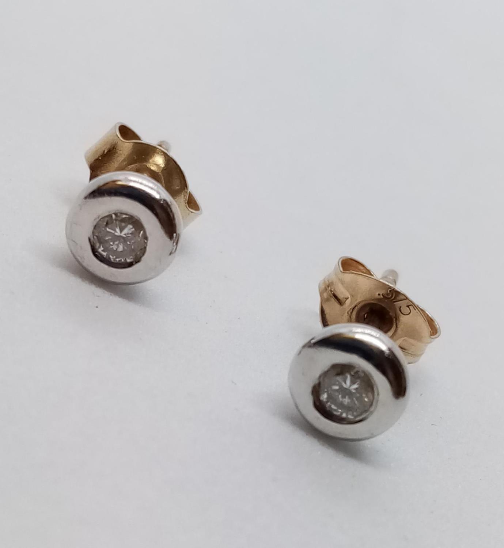 Pair of 9ct Diamond Stud EARRINGS . 2.3g