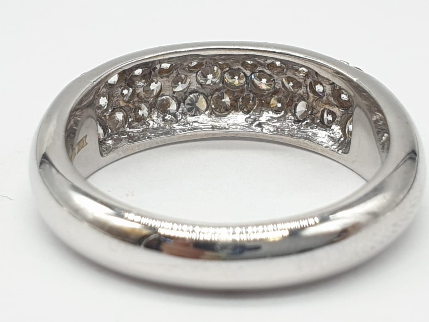 A diamond encrusted 18ct white gold ring. 6.4g and size N. - Image 4 of 7