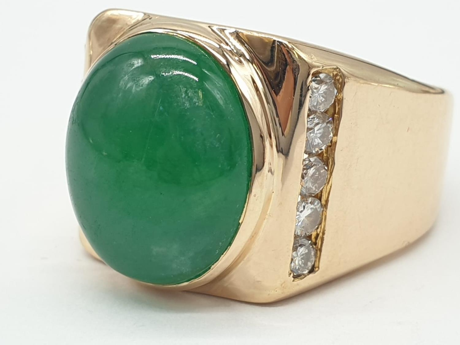 18ct Gold ring with natural jade stone and diamond shoulders. 16.2g total weight and size R.