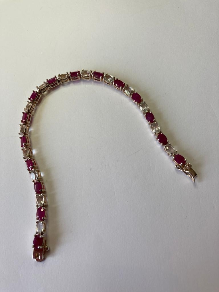 Silver tennis bracelet with pale aqua and pink spinel stones set in four claw mounts. 925 silver. - Image 4 of 4