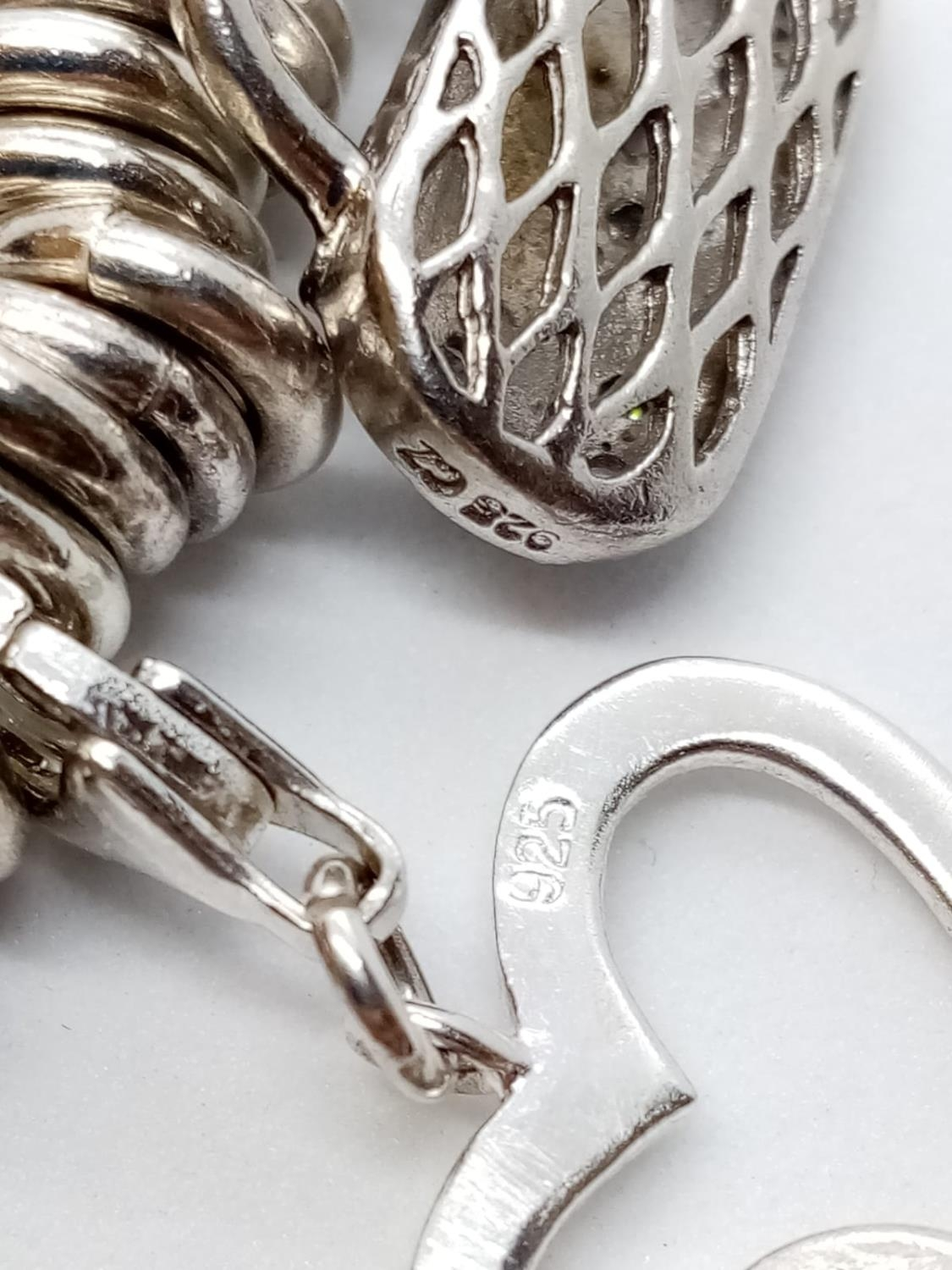 Heavy SILVER BRACELET, London Charm Co. 75.2g 10 charms. - Image 8 of 9