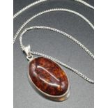 A large Amber Pendant Set in Silver on a 50cm Silver Chain 9.5g