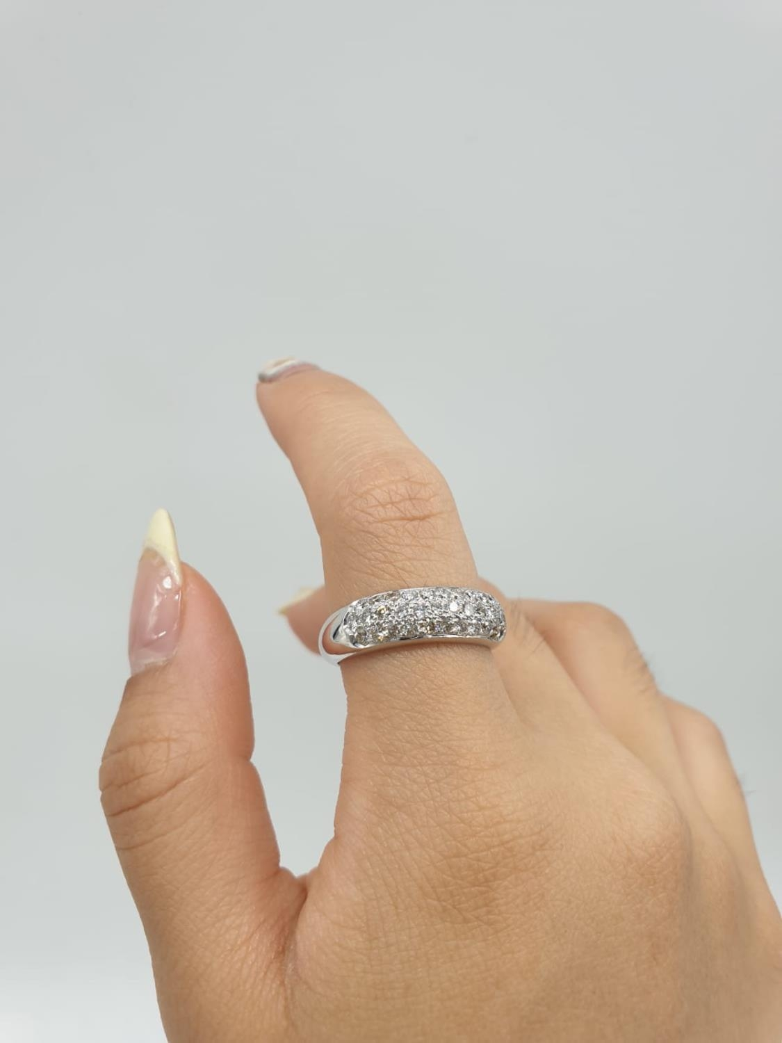 A diamond encrusted 18ct white gold ring. 6.4g and size N. - Image 7 of 7