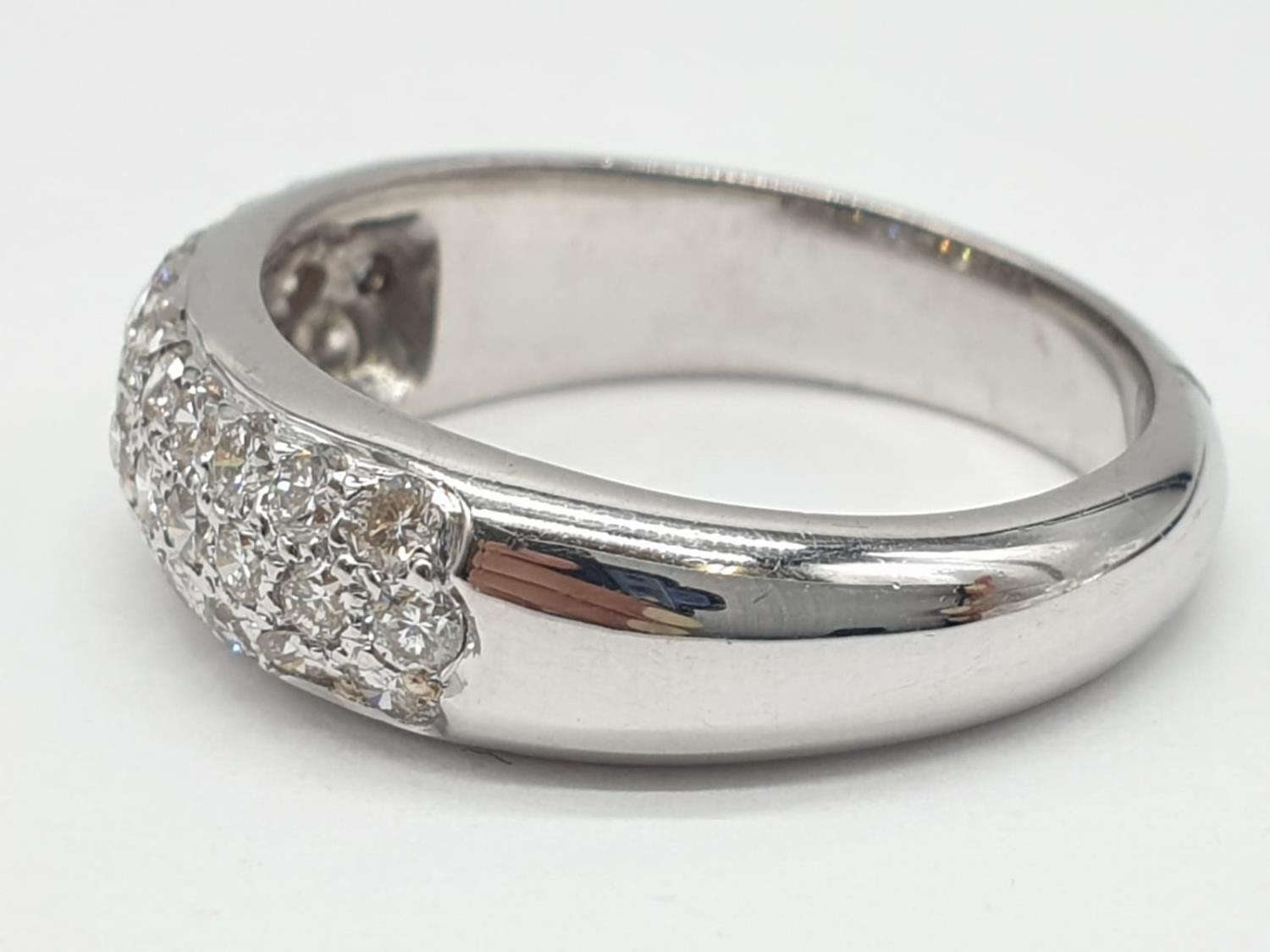 A diamond encrusted 18ct white gold ring. 6.4g and size N. - Image 3 of 7