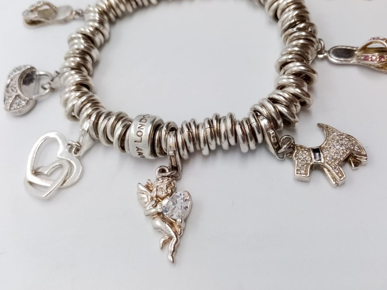 Heavy SILVER BRACELET, London Charm Co. 75.2g 10 charms. - Image 3 of 9