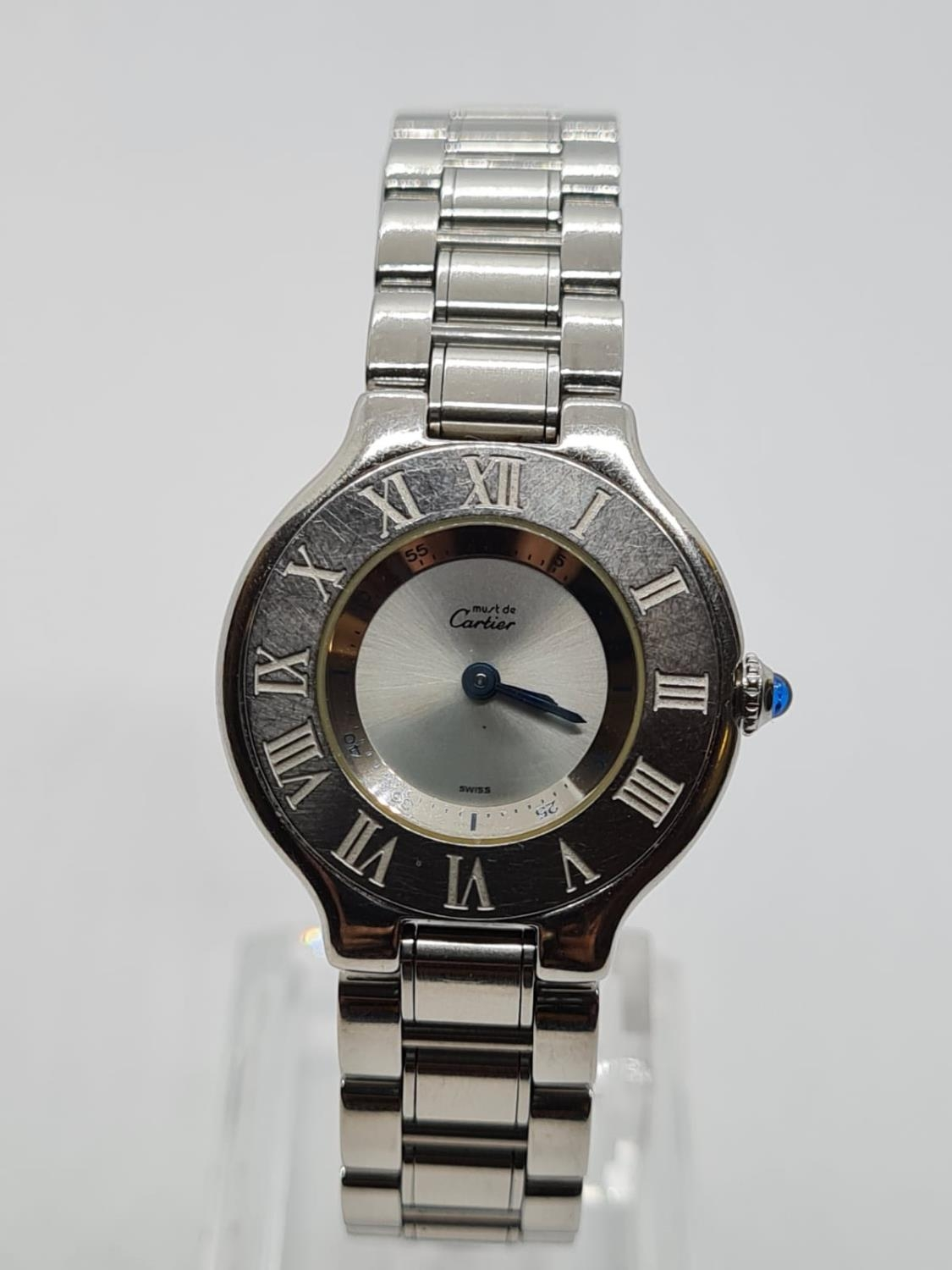 Must de Cartier Ladies WATCH with round face and Roman Numerals. 28mm case.