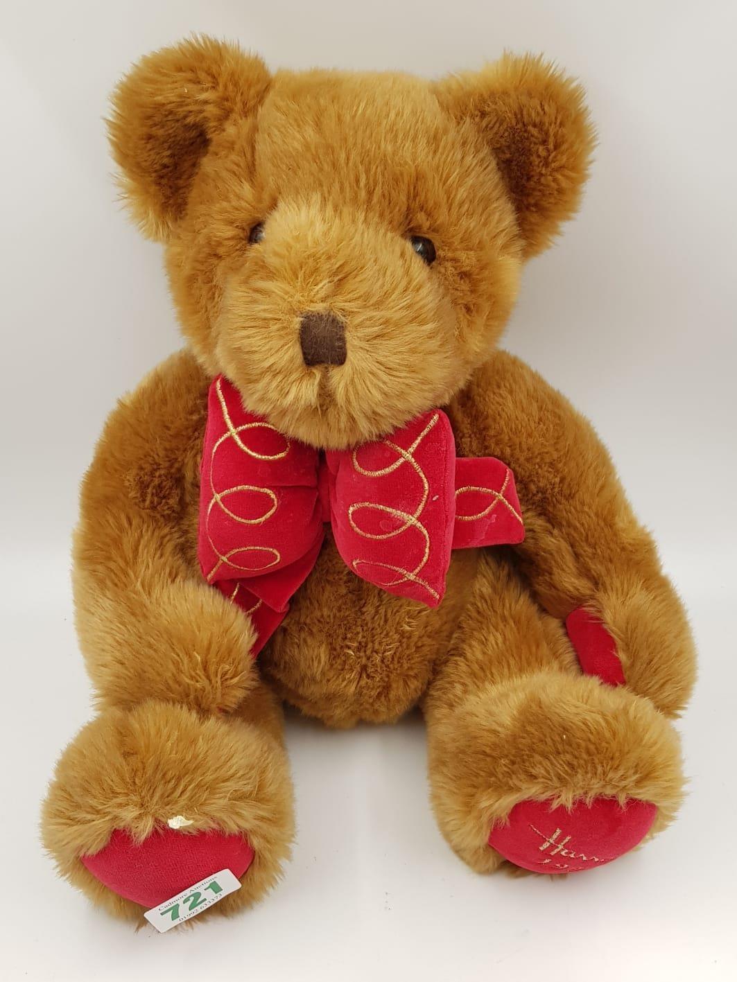 A 1997 Harrods teddy bear. 35cm high.