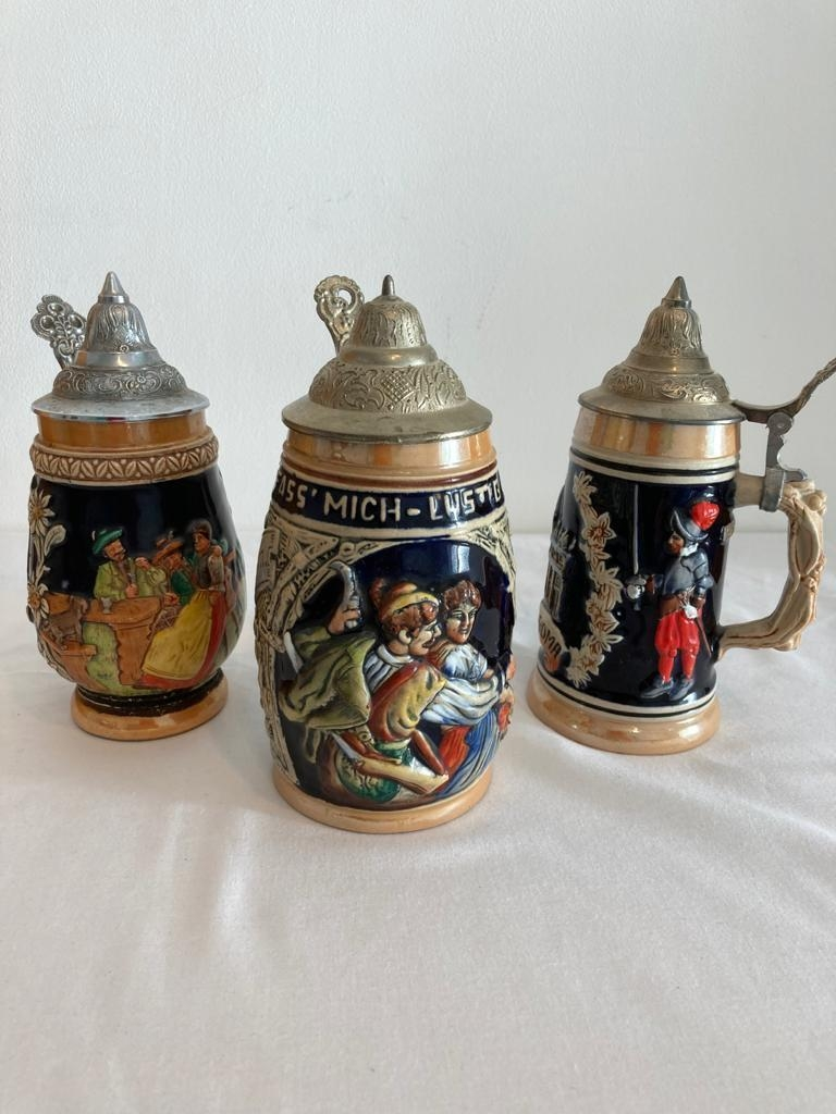 Collection of 3 German beer Steins, all having lids and the DBGM marking for genuine and original