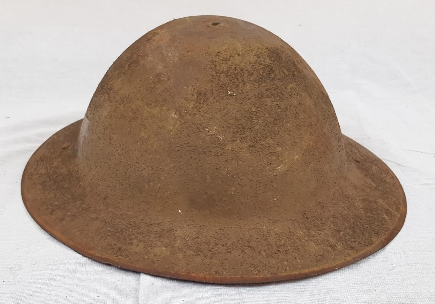 WW1 British Brodie Helmet with insignia to the Royal Berkshire Regiment. Makers Mark for Hadfield