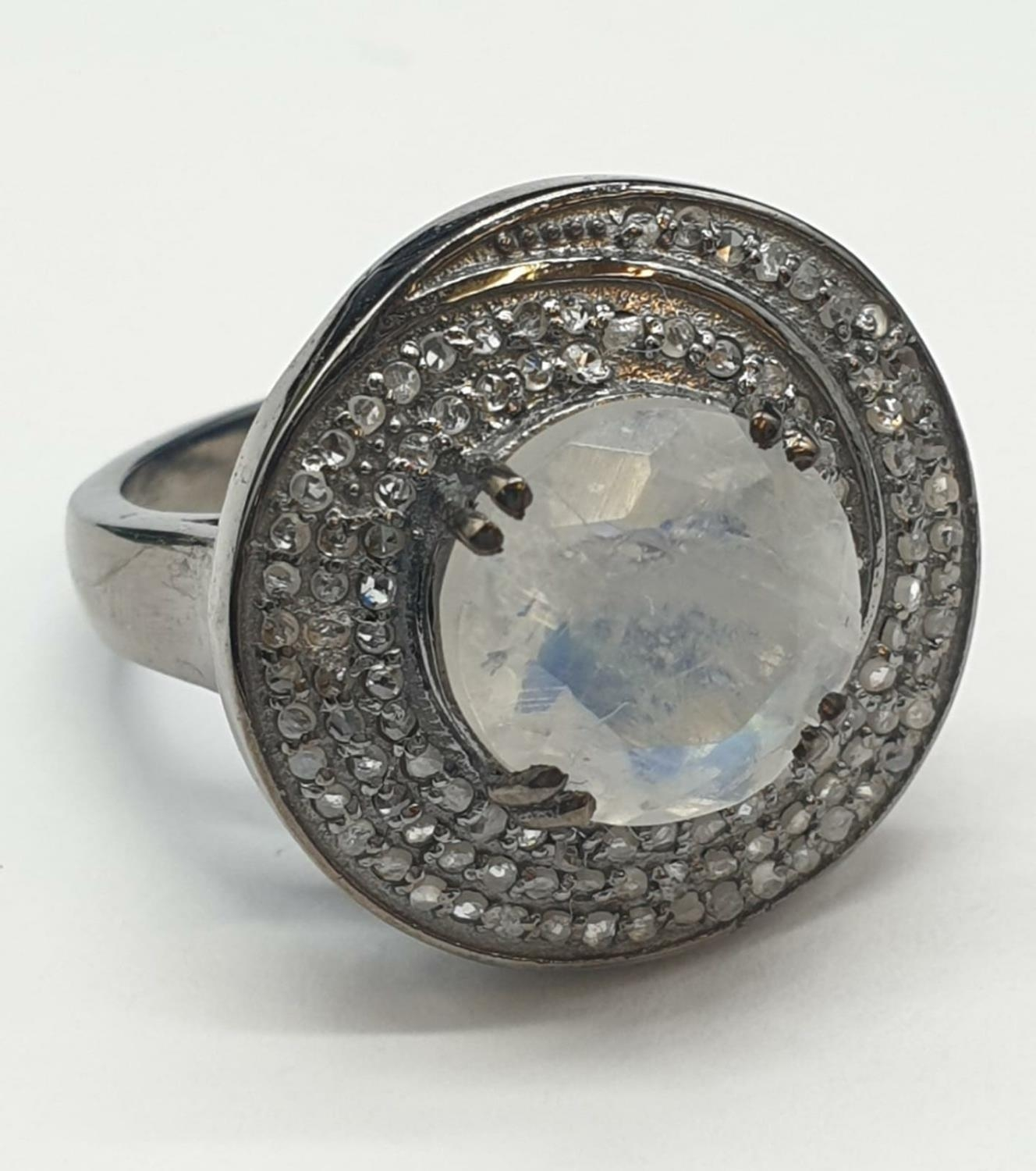 4 Ct Moonstone Ring with 0.75 Ct Rose cut diamonds. Blackened silver.