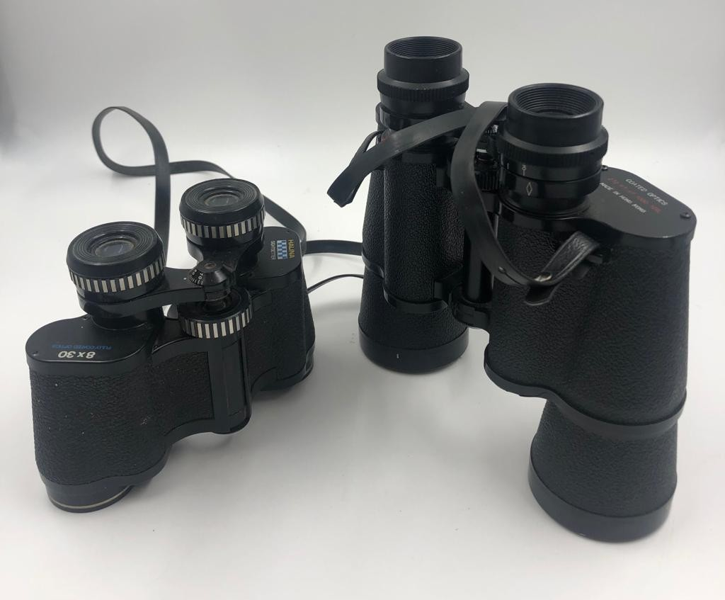 2 x pairs of BINOCULARS. A pair of Prinz, 10 x 50 coated optics with case and a smaller pair of