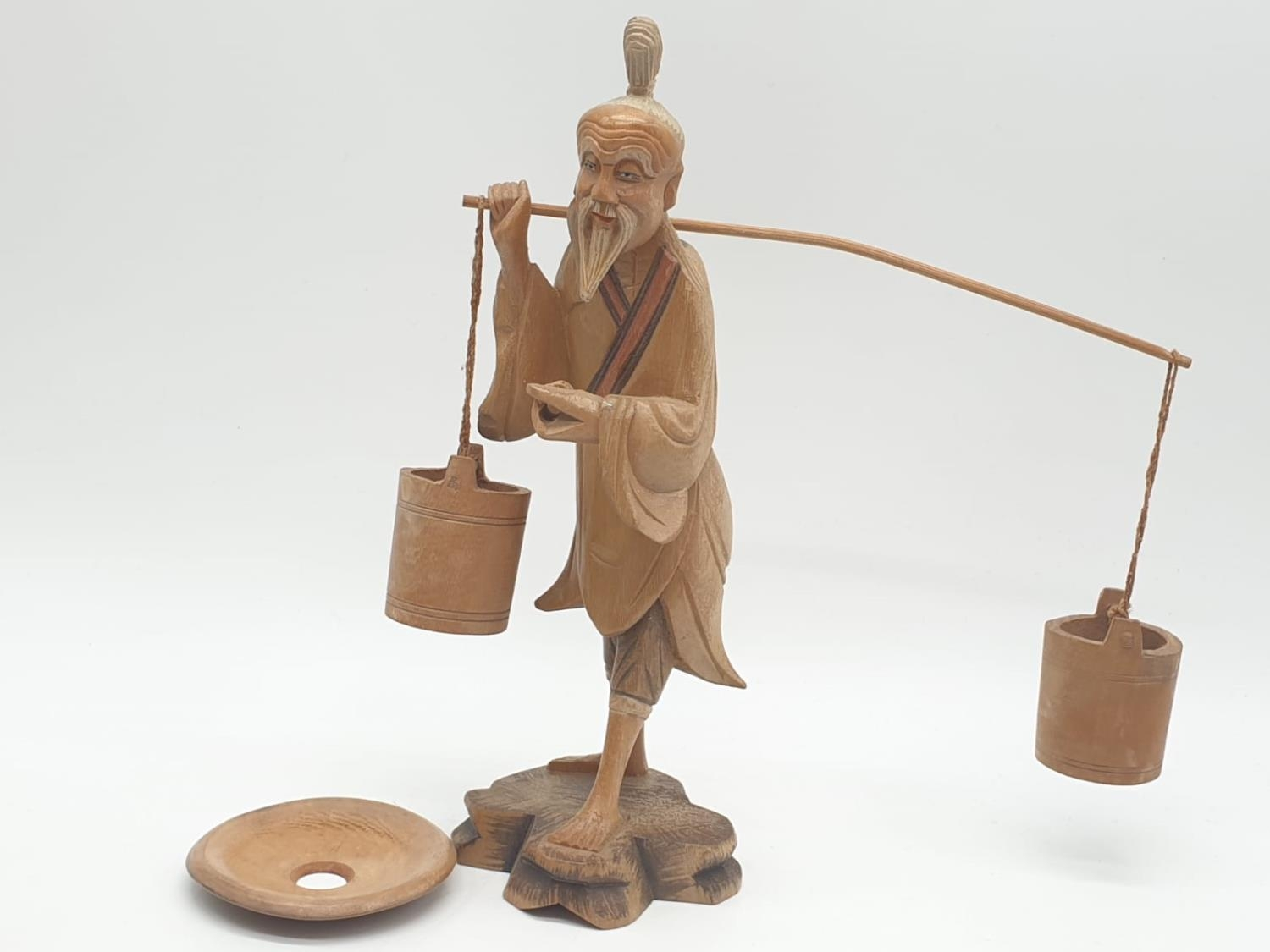 Hand carved wooden figure a Chinese pedlar. 20cm tall.